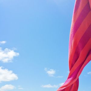 orange and red cloth with open sky background. In blog post Jesus stops for you.